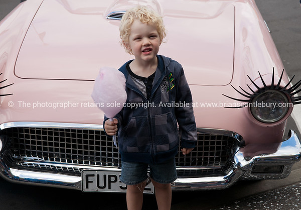 Whangamata Beach Hop 2012. Boy with pink candy floww.