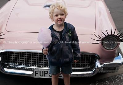 Whangamata Beach Hop 2012. Boy with pink candy floww.