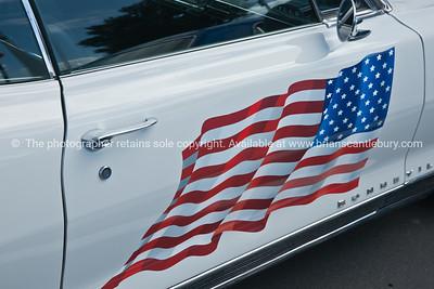 Whangamata Beach Hop 2012. US flag on Bonneville car door.
