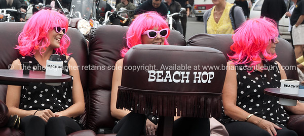Whangamata Beach Hop 2012. Pink hair on a Lazboy.