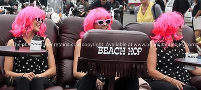 Whangamata Beach Hop 2012. Pink hair on a Lazboy.