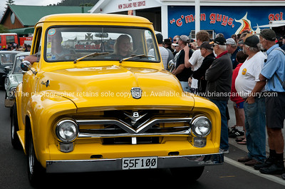 Whangamata Beach Hop 2012. Yellow Ford V8 truck un parade, 55F1 00.