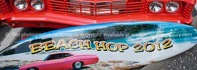 Whangamata Beach Hop 2012.Beach Hop 2012 sign surfboard.