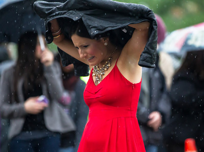 Many of the well dressed attendees, like NY1 traffic reporter Jamie Shupack  were caught in a downpour entering the hotel.