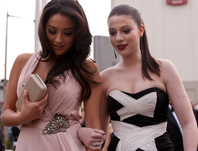 Shay Mitchell and Michelle Trachtenberg Mitchell is a Canadian actress and model. She stars in the ABC Family original series, Pretty Little Liars as Emily Fields. Trachtenberg is an American television and film actress. She is known for her roles as Dawn Summers in the television series Buffy the Vampire Slayer and as Georgina Sparks in Gossip Girl, and in the films Harriet the Spy; Inspector Gadget (1999); EuroTrip; Ice Princess; Black Christmas and 17 Again.
