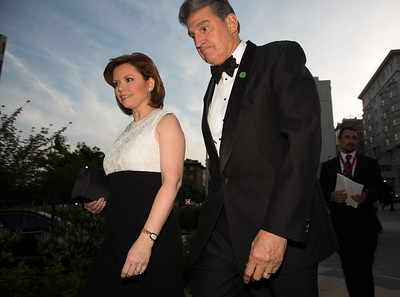 NBC political reporter Kelly O'Donnell and Sen. Joe Manchin walk to Hilton for White House Correspondents Dinner.