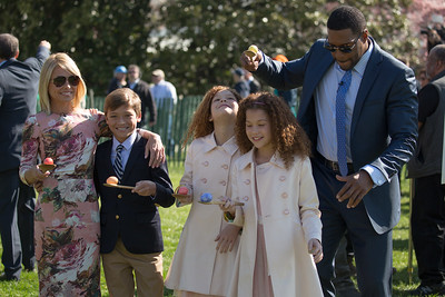 Talk show hosts Kelly Ripa and Michael Strahan, who broadcast their program from the South Lawn, with their kids