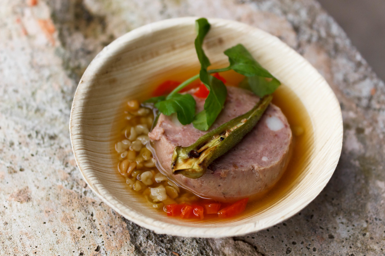 Scotch Bonnet Consommé with Rabbit Torchon, blistered okra, einkorn & berbere