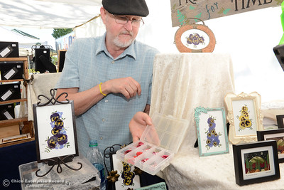 Gary Jensen, of Pressed for Time, shows his pressed flowers that he uses to create art pieces Saturday, April 2, 2016, during the Wildflower Festival in Oroville, California. (Dan Reidel -- Enterprise-Record)