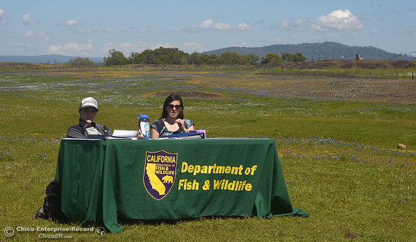 Department of Fish and Wildlife interns Kristen Peck, left, and Haley Henderson greet people who enter area to see Table Mountain wildflowers Saturday, April 2, 2016, during the Wildflower Festival in Oroville, California. (Dan Reidel -- Enterprise-Record)