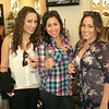 Participants of the wine and dine event enjoying wine at Donald J. Pliner, one of the participating stores.