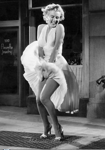 Marilyn-Monroe-strikes-her-famous-pose-in-her-white-halter-dress-from-The-Seven-Year-Itch-1