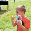 Caden Brunk, 8, of Canfield, Ohio, enjoys a sno-cone as he awaits his turn to take a helicopter ride. — Sam Luptak Jr.