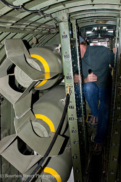 Walking through the bomb bay, between the bomb racks.