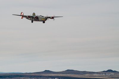 B-24J Witchcraft landing at ABQ with west mesa volcanoes in the background.