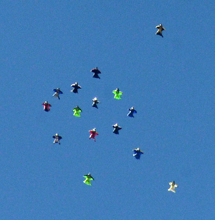 """Wingsuit skydivers move into formation to make the dive official, A video/photographer diver is top right to document the event.<br /> A group of Colorado wingsuit skydivers set a Colorado record this weekend at 14 people at Vance Brand Airport and  Mile-Hi Skydiving in Longmont.<br /> For more photos and a video, go to www.dailycamera or  <a href=""""http://www.timescall.com"""">http://www.timescall.com</a>.<br /> Cliff Grassmick  / October 21, 2012"""
