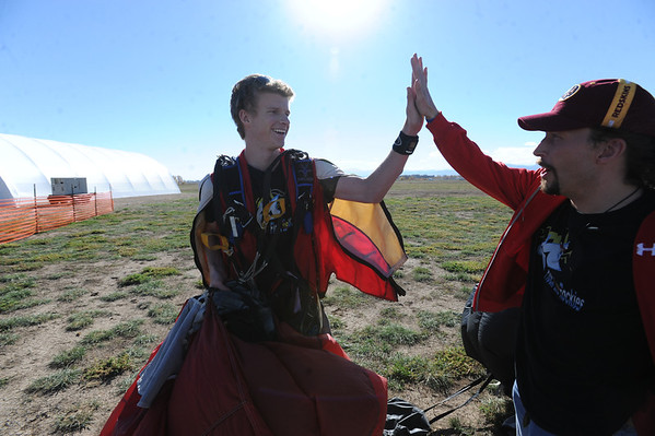 "Chris Lierheimer, left, gives Joel Steverson a high five after the third record attempt.<br /> A group of Colorado wingsuit skydivers set a Colorado record this weekend at 14 people at Vance Brand Airport and  Mile-Hi Skydiving in Longmont.<br /> For more photos and a video, go to www.dailycamera of  <a href=""http://www.timescall.com"">http://www.timescall.com</a>.<br /> Cliff Grassmick  / October 21, 2012"