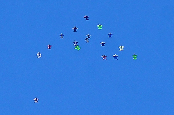 "The wingsuit skydivers  attempted 17 people early Sunday, but failed in keeping the formation.<br /> A group of Colorado wingsuit skydivers set a Colorado record this weekend at 14 people at Vance Brand Airport and  Mile-Hi Skydiving in Longmont.<br /> For more photos and a video, go to www.dailycamera of  <a href=""http://www.timescall.com"">http://www.timescall.com</a>.<br /> Cliff Grassmick  / October 21, 2012"