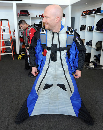 """Jason Hill gets his wing suit on for the record jump.<br /> A group of Colorado wingsuit skydivers set a Colorado record this weekend at 14 people at Vance Brand Airport and  Mile-Hi Skydiving in Longmont.<br /> For more photos and a video, go to www.dailycamera of  <a href=""""http://www.timescall.com"""">http://www.timescall.com</a>.<br /> Cliff Grassmick  / October 21, 2012"""