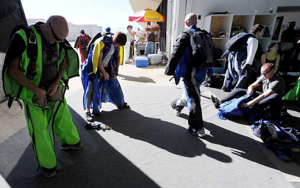 """Vit Steiger, left, and David Smith, join other team members dressing in their wingsuits.<br /> A group of Colorado wingsuit skydivers set a Colorado record this weekend at 14 people at Vance Brand Airport and  Mile-Hi Skydiving in Longmont.<br /> For more photos and a video, go to www.dailycamera of  <a href=""""http://www.timescall.com"""">http://www.timescall.com</a>.<br /> Cliff Grassmick  / October 21, 2012"""