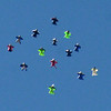 """Wingsuit skydivers move into formation to make the dive official, A video/photographer is out of the frame, but did  document the attempt.<br /> A group of Colorado wingsuit skydivers set a Colorado record this weekend at 14 people at Vance Brand Airport and  Mile-Hi Skydiving in Longmont.<br /> For more photos and a video, go to www.dailycamera of  <a href=""""http://www.timescall.com"""">http://www.timescall.com</a>.<br /> Cliff Grassmick  / October 21, 2012"""