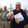 Winslow School reunion in Tyngsboro. Chris Bunker '66 of Pelham, left, and Dave Chouinard '65 of Tyngsboro, showing his class ring. (SUN/Julia Malakie)