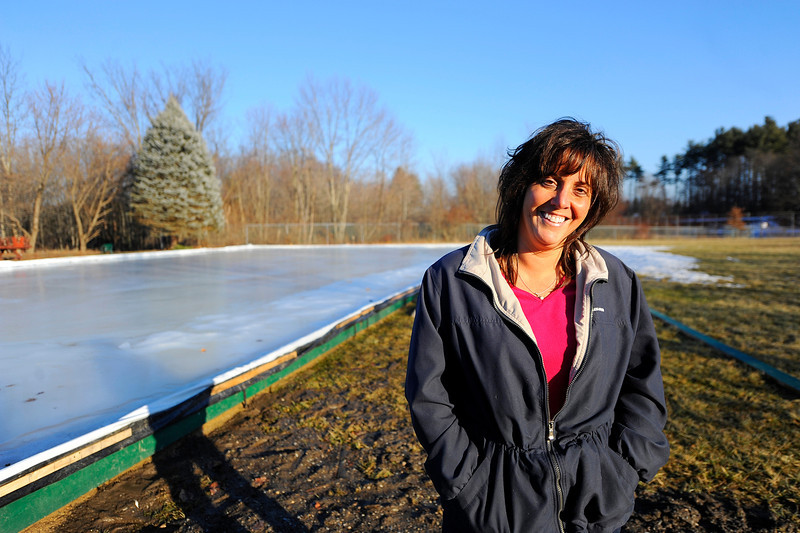 Susan Smiley, a member of the Lancaster Thayer Field Campus committee, stands by the ice skating rink on January 17, 2014, located behind the Thayer Memorial Library, which will be part of the upcoming Winter Festival event.<br /> SENTINEL & ENTERPRISE / BRETT CRAWFORD