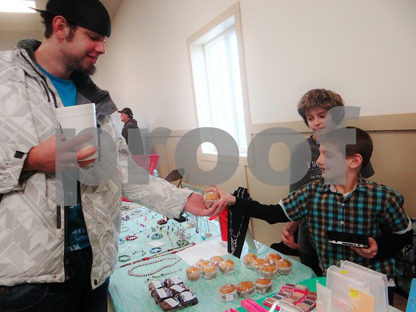 Brandon Meyers buying delicious baked goods from HeavynLee Jewels (Zachary and Aidan Pate)