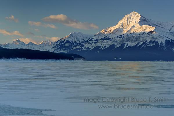 Frozen mountain lake sunrise