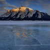 Sunset mountain reflection on the ice