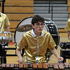 Max Park, senior at Dedham High School, plays xylophone as Dedham High competes. Tewksbury Memorial High School hosts the New England Scholastic Band Association's competition. (SUN/Julia Malakie)