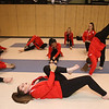 Tewksbury Memorial High School hosts the New England Scholastic Band Association's competition. Tewksbury's Affinity Winter Color Guard, including senior Janine Richardson, front, stretches before competition. (SUN/Julia Malakie)