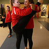 Tewksbury Memorial High School hosts the New England Scholastic Band Association's competition. Tewksbury's Affinity Winter Color Guard including sophomore Meredith Whealan, left, and senior Sarah Michaud, right, stretches before competition. (SUN/Julia Malakie)