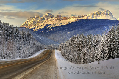 Snowy winter road in the mountains west of Jasper, Alberta.