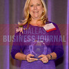 Gina Betts, Squire Patton Boggs, with her 2014 Dallas Bsuiness Journal Women in Business award.