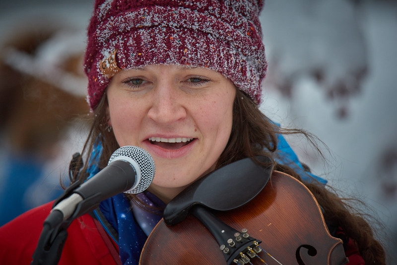 """Musician Aurora Bowers performs the song """"Rattle Those Chains"""" at the Women's March held in Fairbanks Alaska on January 20, 2018."""