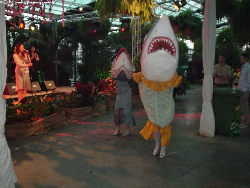 Rose performing and two performers in fish suits