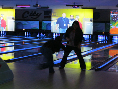 They had us stop and do some more challenging bowling moves.  For this one one person had to toss the bowling ball between the other persons legs.