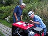 Roger and John fine tuning another machine on the Island.