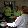 Keepers John and Darlene fix sawmill gravy, sausage, grits and biscuits.