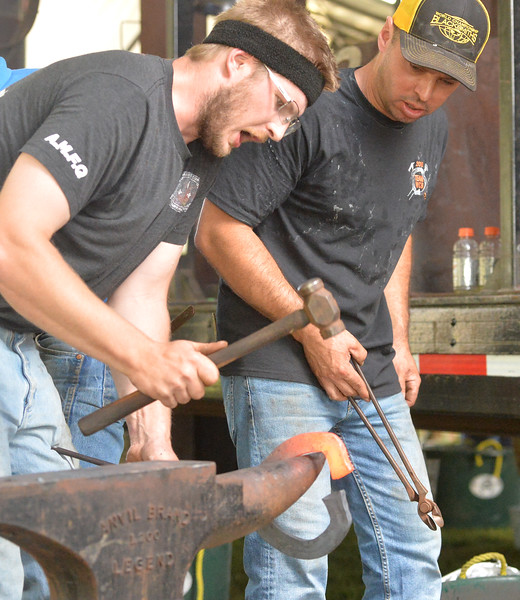 Ryan Patterson | The Sheridan Press<br /> Travis Buck of Glen Williams, Ontario, left, competes in the World Championship Blacksmiths competition at the Big Horn Equestrian Center Saturday, Sept. 1, 2018.