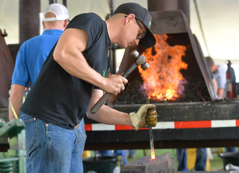 Ryan Patterson | The Sheridan Press<br /> Riley Kirkpatrick of Sheridan, Oregon, competes in the World Championship Blacksmiths competition at the Big Horn Equestrian Center Saturday, Sept. 1, 2018.