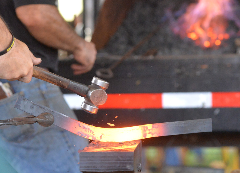 Ryan Patterson | The Sheridan Press<br /> A competitor molds a horseshoe during the World Championship Blacksmiths competition at the Big Horn Equestrian Center Saturday, Sept. 1, 2018.
