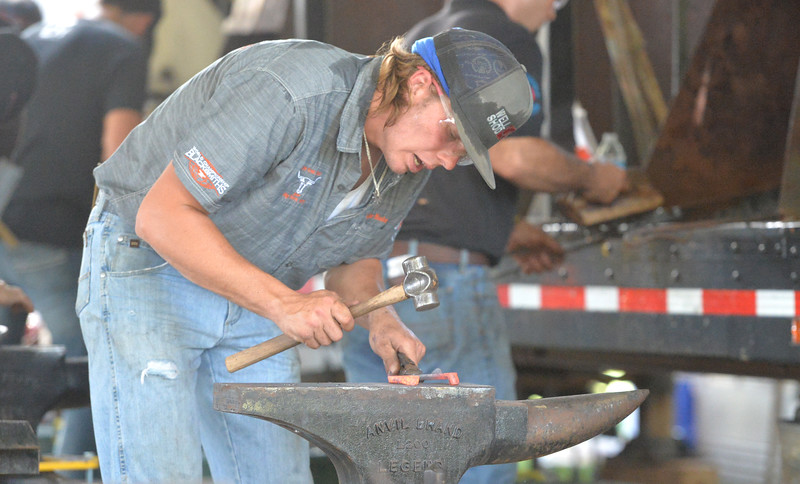 Ryan Patterson | The Sheridan Press<br /> Colter Manley of Ucross competes in the World Championship Blacksmiths competition at the Big Horn Equestrian Center Saturday, Sept. 1, 2018.