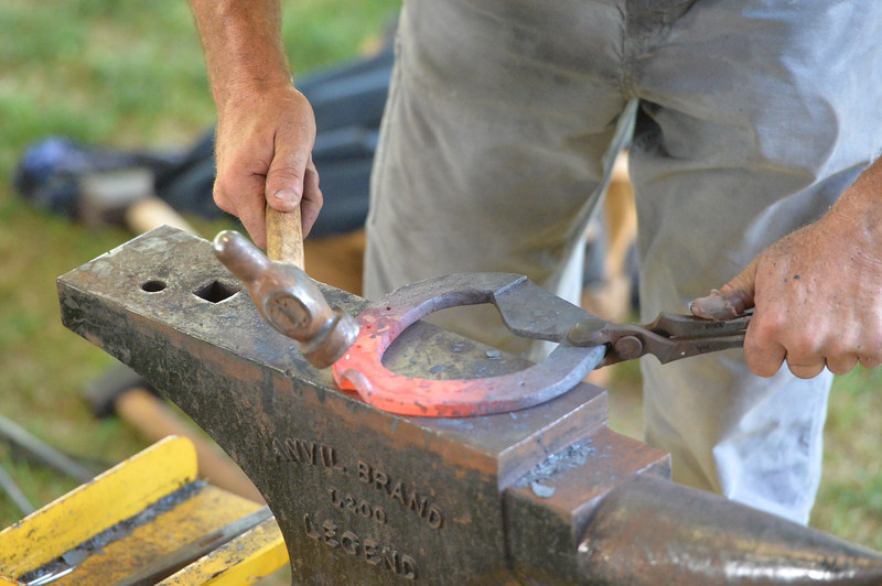 Ryan Patterson | The Sheridan Press<br /> A competitor works on a horseshoe in the World Championship Blacksmiths competition at the Big Horn Equestrian Center Saturday, Sept. 1, 2018.