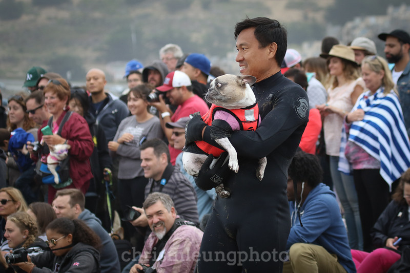 8/5/17: Cherie and Michael Uy during the 2017 World Dog Surfing Championships at Pacifica State Beach in Pacifica, Ca by Chris M. Leung