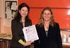 Cllr Lorna Reith presents the school headteacher with a certificate