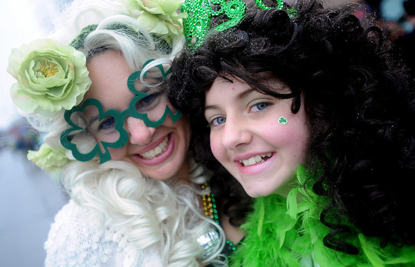 "Dana Bacardi, left, and her daughter, Abby, hug after performing with the Paddy O ""Furniture Drill Team.<br /> The annual World's Shortest St Patrick's Day Parade was held in front of Conor O'Neills on Sunday.<br /> For more photos and a video, go to  <a href=""http://www.dailycamera.com"">http://www.dailycamera.com</a>.<br /> Cliff Grassmick / March 14, 2010"