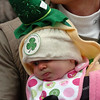 "Sidney Donnelly, 5-months, peeks out to see the parade with her father Sean.<br /> The annual World's Shortest St Patrick's Day Parade was held in front of Conor O'Neills on Sunday.<br /> For more photos and a video, go to  <a href=""http://www.dailycamera.com"">http://www.dailycamera.com</a>.<br /> Cliff Grassmick / March 14, 2010"