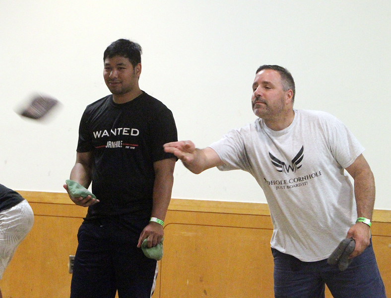 Lowell Elks hold fundraiser to benefit Wounded Warriors. Johnny Sok of Dracut, left, and Jim Bottis of Worcester play cornhole. (SUN/Julia Malakie)